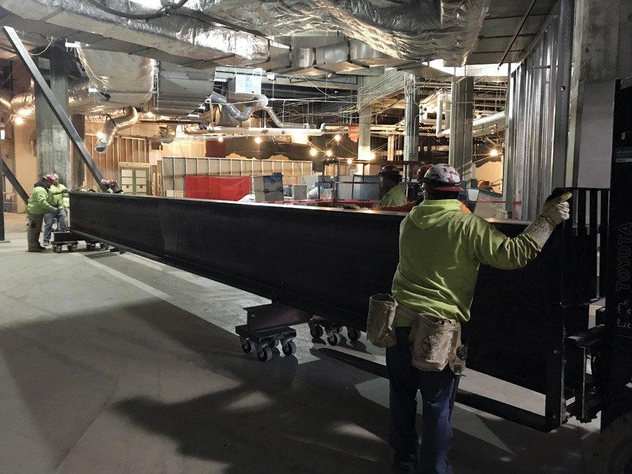 Six-ton steel girder arriving onsite.