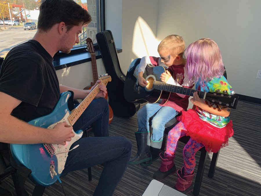 Guitar lessons are among musical offerings of the new Madcap Education Center.