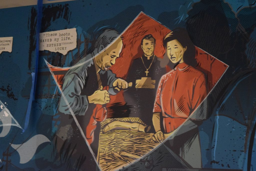 Portion of a 60-foot, graphic-novel style mural, which features stories of WWII Holocaust liberators and survivors with local ties. The artist is Keith Neltner, who created 25 vignettes in all.